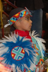 Native dancer looking on.