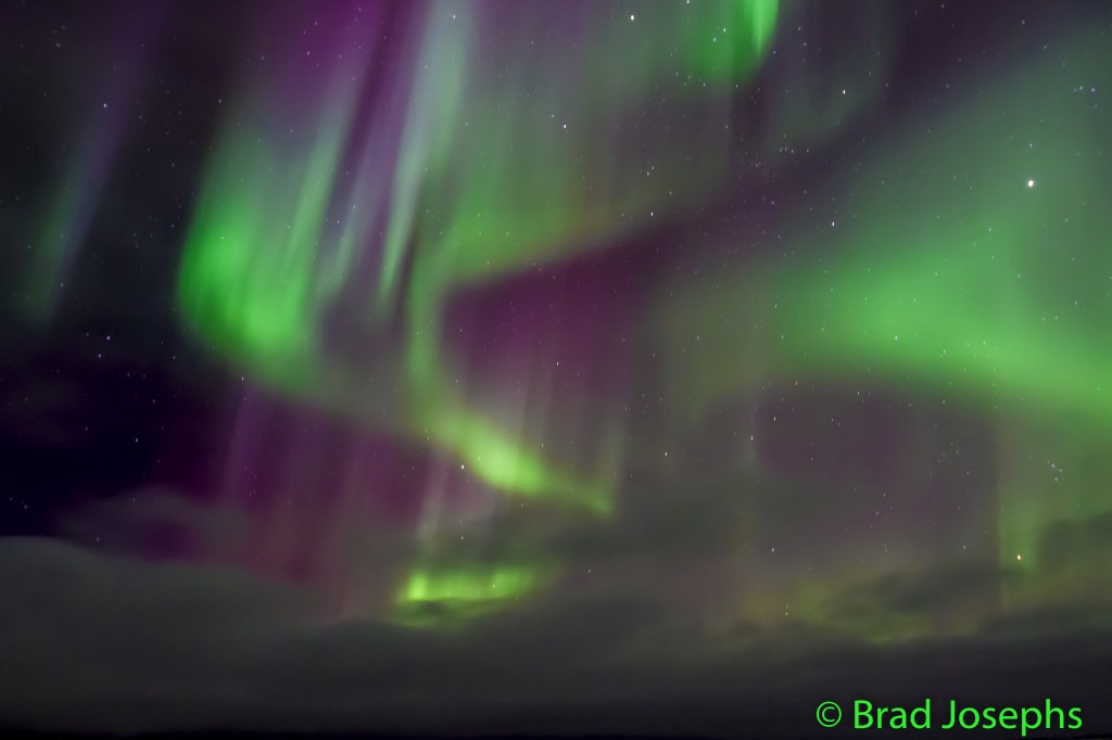 Northern light shine above Churchill and the Hudson Bay.