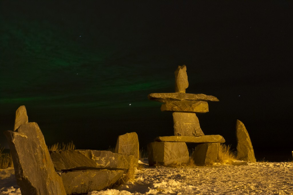 Northern lights over the Hudson Bay behind the Inukshuk in Churchill. Sean Beckett photo.