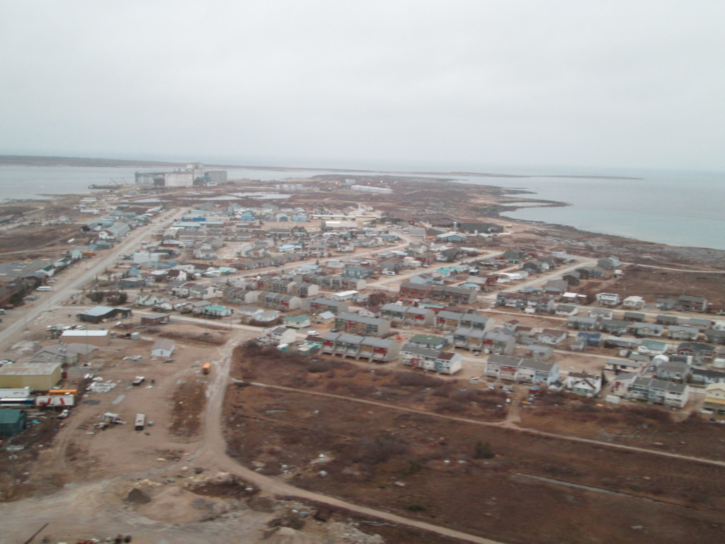 Traveling by helicopter to a polar bear den the traveler gets a view above Churchill, Manitoba.