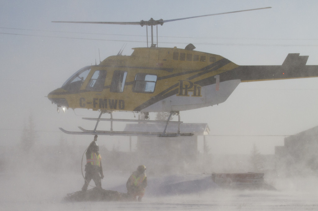 Hudson Bay helicopters transports bears northwest from the polar bear compound in Churchill, Manitoba.