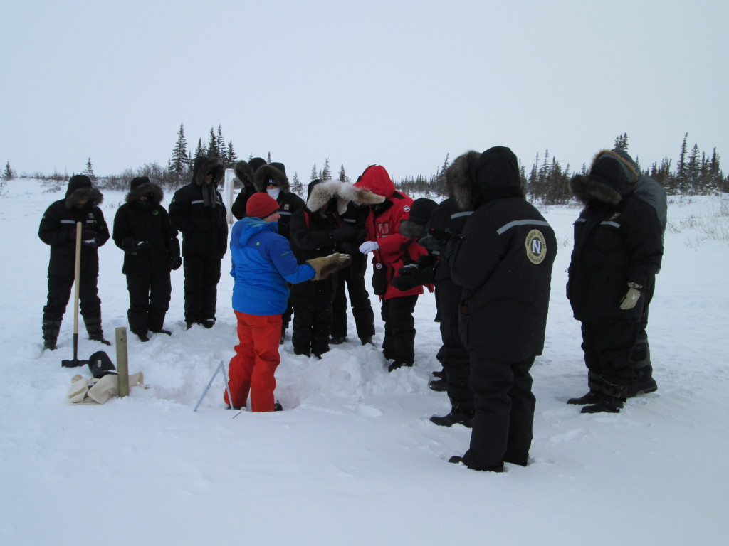 Researcher explaining the snow sampling process to Natural Habitat travelers. Churchill, Manitoba.