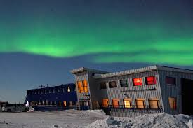 Churchill Northern Studies Center with aurora borealis. Churchill, Manitoba.