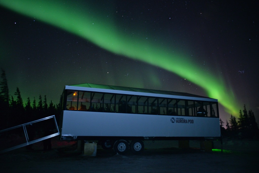 Natural Habitat Aurora Pod with northern lights.