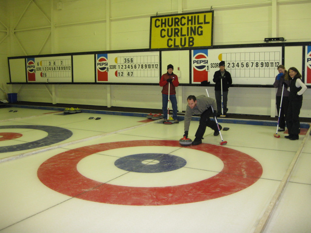 Natural Habitat travelers enjoy a curling experience in Churchill. Karen Walker photo.