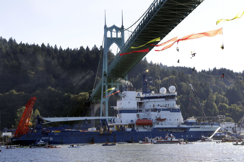 The Royal Dutch Shell PLC icebreaker Fennica heads up the Willamette River under protesters hanging from the St. Johns Bridge on its' way to Alaska in Portland, Ore., Thursday, July 30, 2015. (AP Photo/Don Ryan) ORDR125 (Don Ryan / The Associated Press)