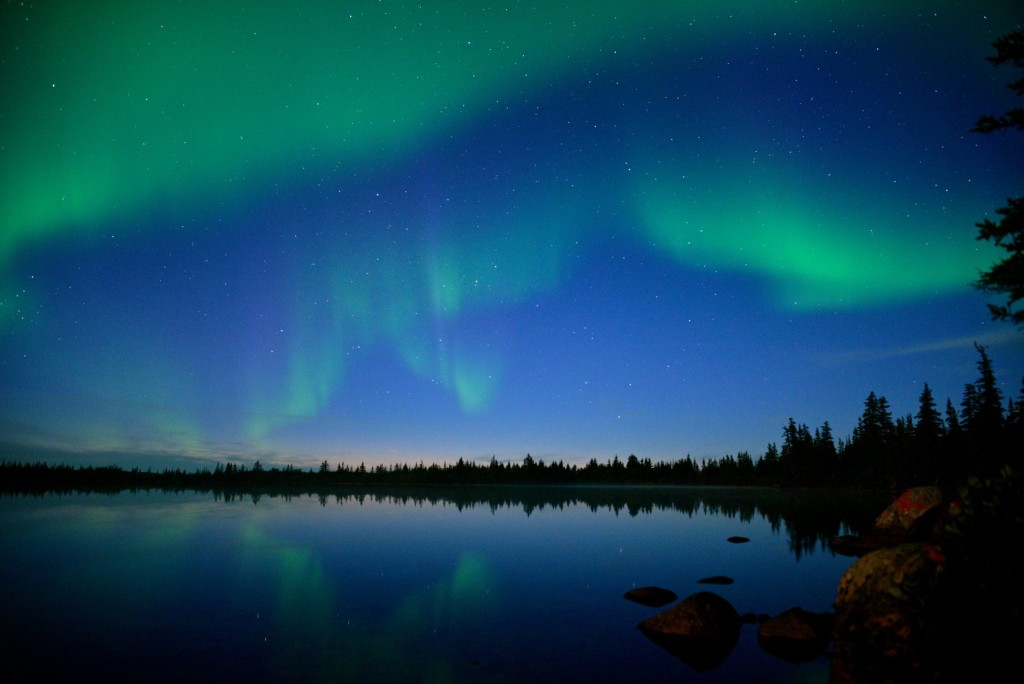 Subtle yet vibrant northern lights in a pale blue sky. Alex De Vries - Magnifico photo.