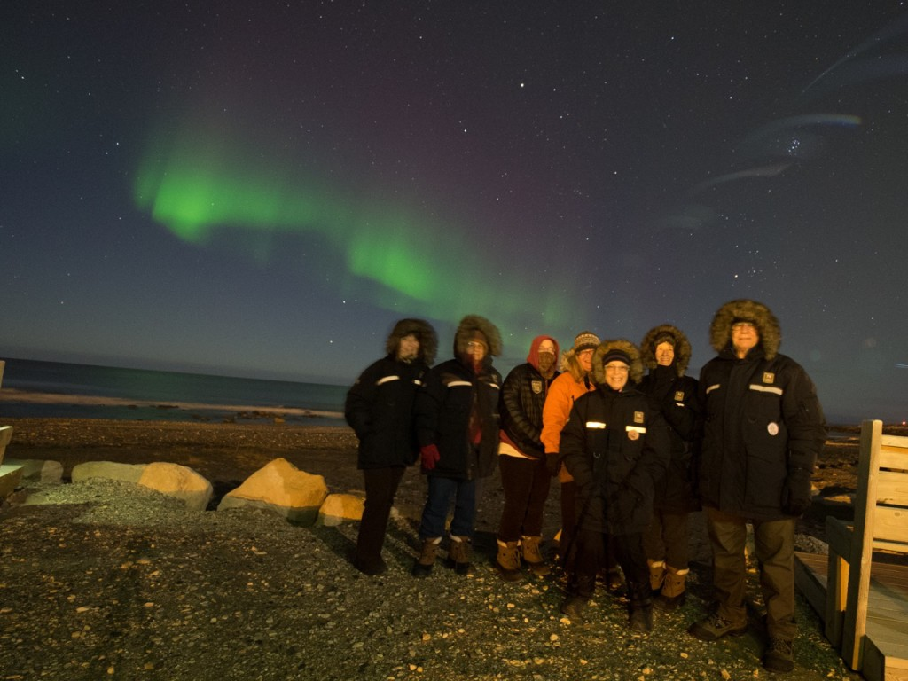 Natural Habitat Adventures travelers and northern lights.
