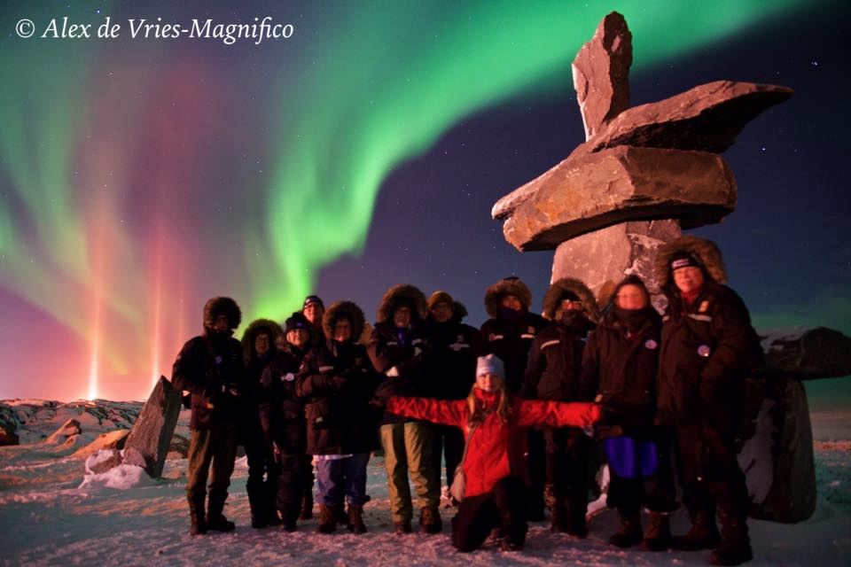 natural habitat group under northern lights Churchill, Manitoba