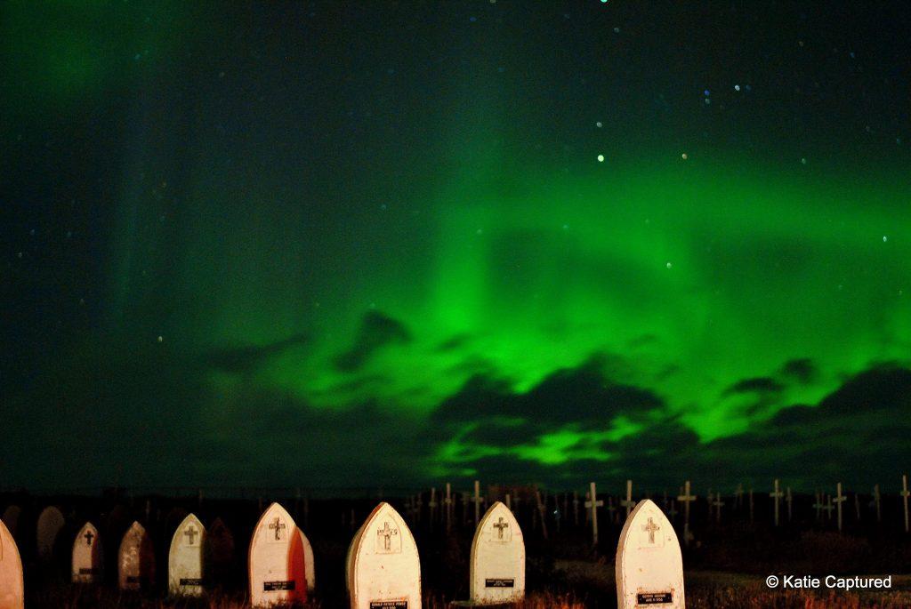 Churchill graveyard and aurora borealis.