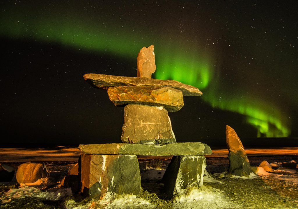 northern lights churchill inukshuk