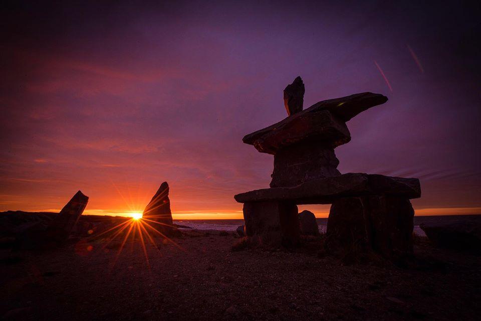 Churchill Sunset over inukshuk