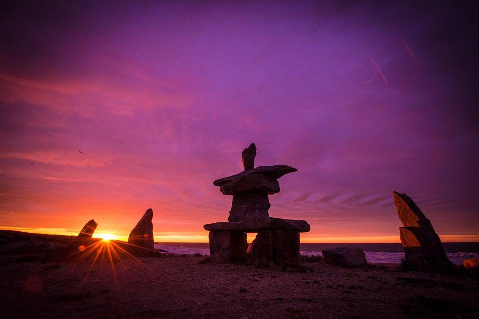 Inukshuk and sunset Churchill Manitoba