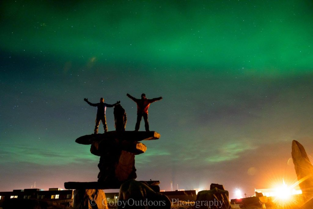 Inukshuk in Churchill aurora borealis