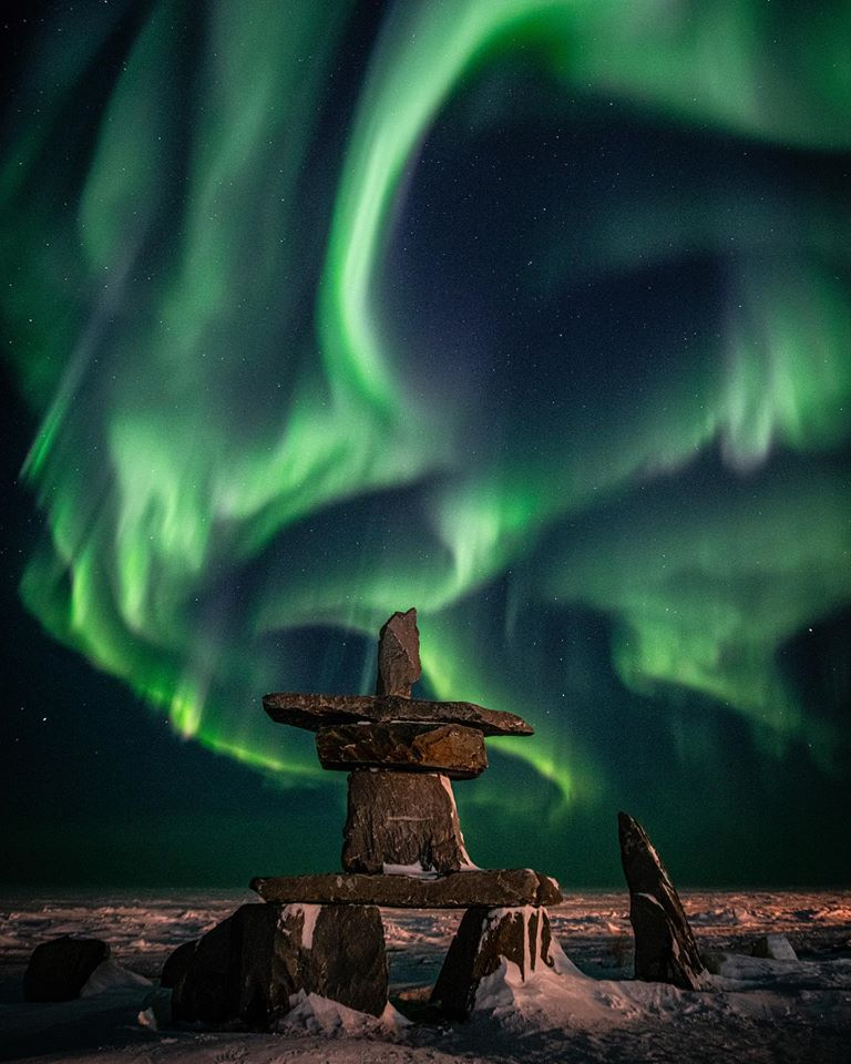 Inukshuk and northern lights in Churchill